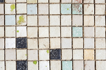 Close up old and dirty small tile floor