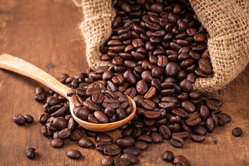 coffee bean on the wood table with spoon and sack