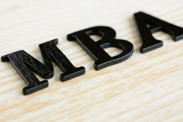 MBA (or Master of Business Administration) sign on wood background
