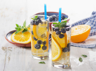 Detox water with fruit in glasses.