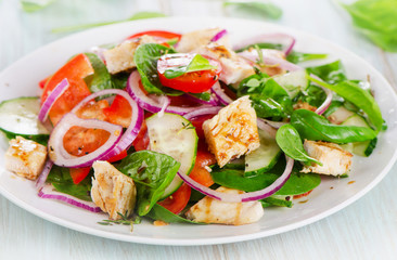 Healthy salad with grilled chicken breast.