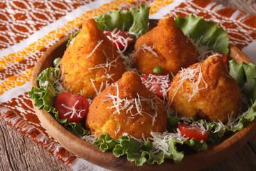 Arancini rice balls stuffed with meat and parmesan closeup. horizontal
