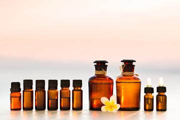 Spa oils in bottles on sunset