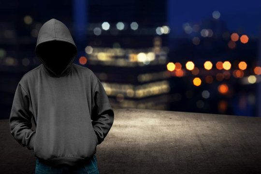 Faceless man in hood on the rooftop