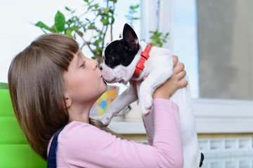 girl with Bulldog puppy