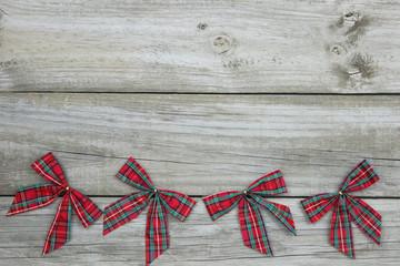 Plaid Christmas bows border rustic wood background