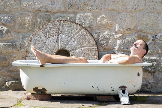 man resting in the outdoor bathtub