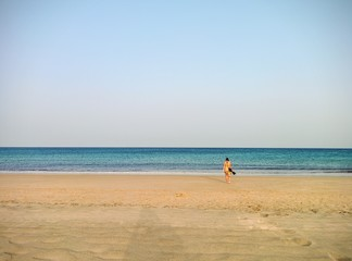 Lonely girl at the beach