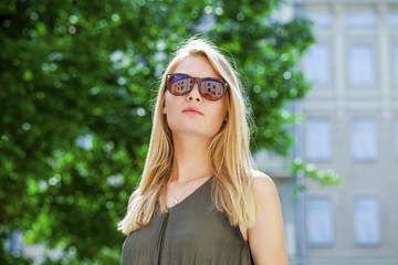 Charming blonde girl in sunglasses
