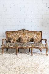 vintage sofa on white wall.