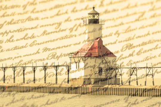 Double exposure St. Joseph north pier lighthouse along shoreline of Lake Michigan with old writing background