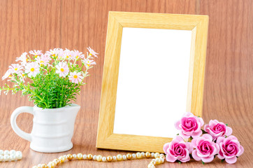 Blank wooden photo frame and pink rose