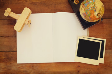 top view of open blank notebook and and blank polaroid photography frames