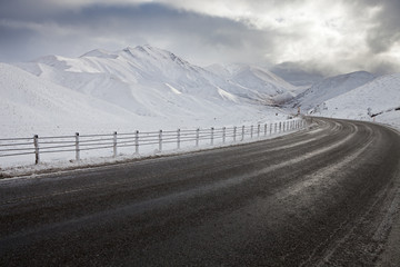 Empty mountain road on a cloudy winter day. South Island, New Zealand