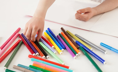 Child choosing a soft-tip pen