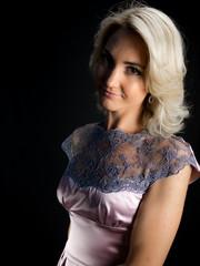 studio Photo of beautiful woman in dress