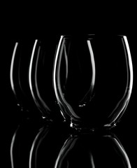 Three glasses on a black background with visible contour