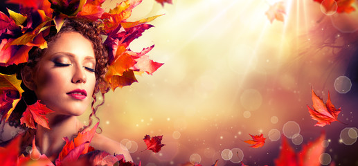 Autumn fantasy girl - Beauty fashion model with red leaves and sunlight