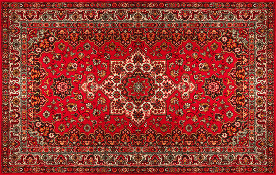 Old Persian carpet with pattern. top view