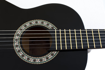 Detail of Classical Acoustic Guitar Isolated on a White Backgrou