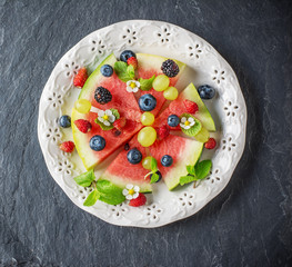 Fruit watermelon pizza with fresh berries and mint