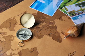 Marine composition with compass and cards on table close up