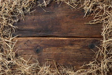 Frame from straw on vintage wooden board