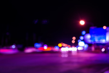 image of blur street  bokeh background with purple tone lights