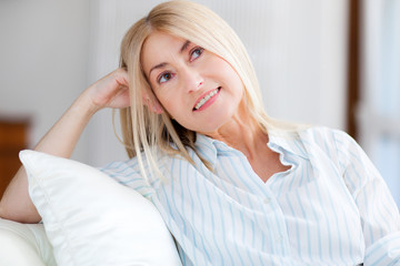 Portrait of a mature woman relaxing on the couch in her home
