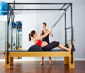 pregnant woman pilates reformer roll up exercise