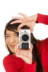 Woman taking a photo with camera.