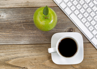 Apple and black coffee with computer keyboard