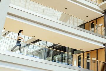 Elegant businesswoman walking inside building