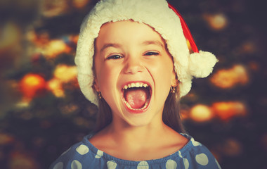 happy child girl in a Christmas hat