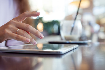 girl works on the digital tablet, a small depth of field, soft