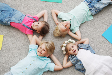 happy kids lying on the floor