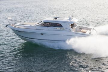 Elegant motor boat sailing at high speed