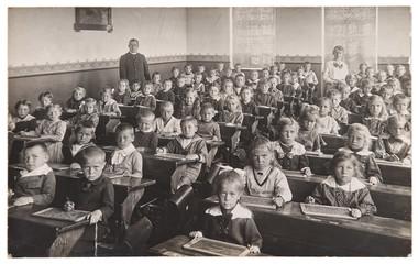 Obraz Children and teacher in the classroom. Back to school concept - fototapety do salonu