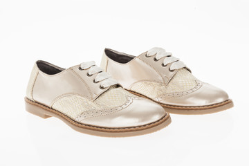 shoe made of pink beige with laces for women on white background