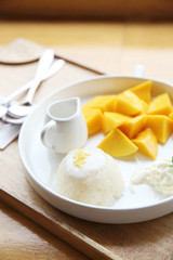 Sticky Rice with Mango on wood background