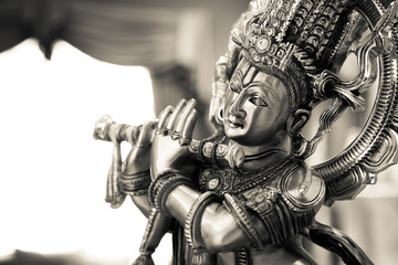 Black and white statue of the Hindu God Krishna playing a flute Wall mural