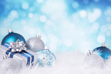 Blue and silver Christmas scene with baubles and gift