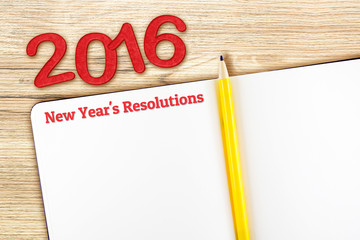 New year's resolutions word on notebook lay on wood table,Templa