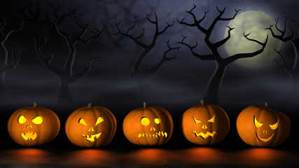 Row of Halloween pumpkins in a spooky forest at night