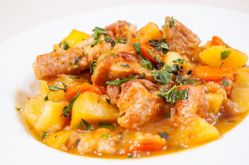 stewed meat with potatoes, onion and carrot