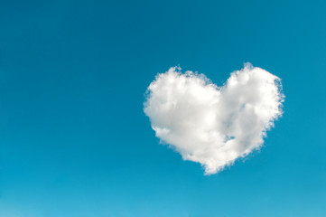 Cloud in the shape of a heart in the blue sky