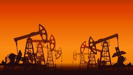 Oil pumps over sunset.