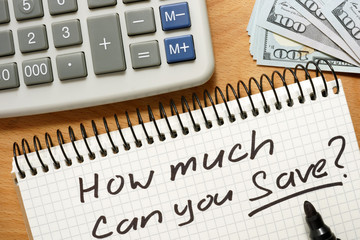 Notepad with how much can you save on a wooden table.