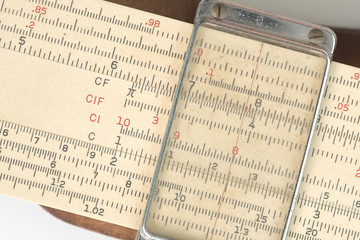 Closeup of Antique calculater, slide rule, over white background.
