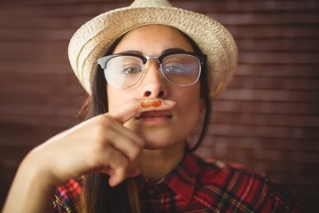 Beautiful hipster with mustache on finger